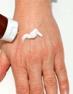 cream on hands