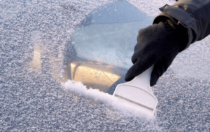 scraping frost off windscreen