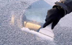 scraping frost off windscreen
