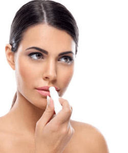 girl applying lip balm stick