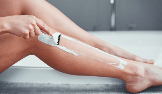 Lady Shaving her legs - hair removal technique