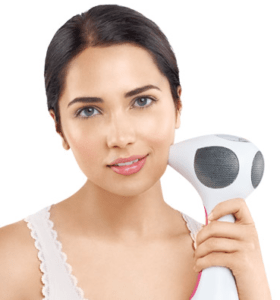 Lady Using Tria Device On Face