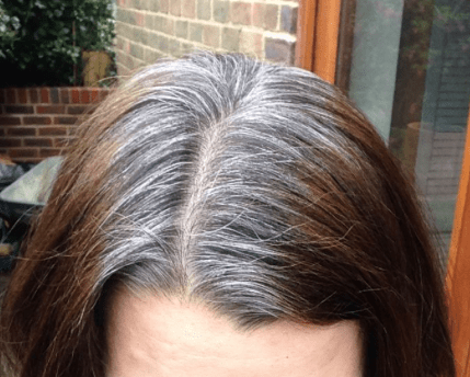 showing more grey hairs